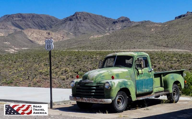Green pickup truck ready to roll on Route 66 between Kingman and Oatma